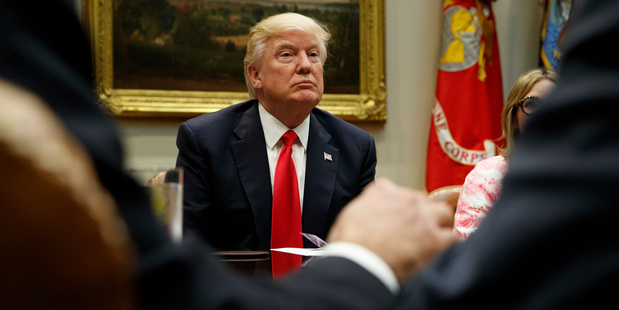 Loading President Donald Trump listens during a meeting with the National Association of Manufacturers. Photo / AP