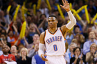 Russell Westbrook acknowledges the crowd after tying the record for triple-doubles in a season. Photo / AP