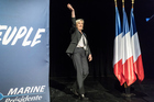 Far-right candidate for the presidential election Marine Le Pen waves during a campaign meeting in Monswiller near Strasbourg, eastern France, April 5, 2017. AP