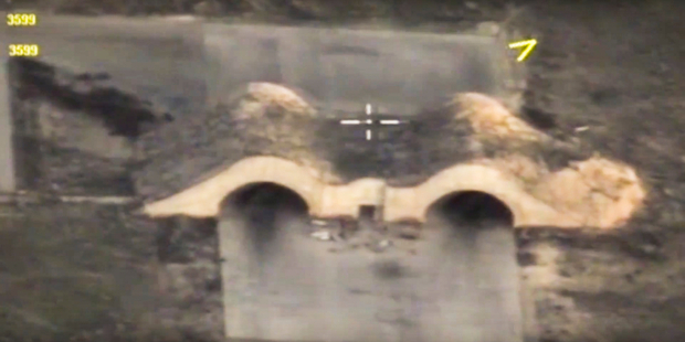 In this photo made from the footage taken from Russian Defense Ministry official web site shows shelters for aircraft at a Syrian airbase after it was hit by US missiles. Photo / AP