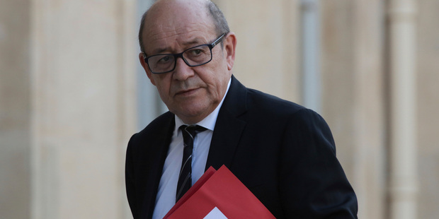 France's Defense Minister Jean-Yves Le Drian arrives for an emergency defense meeting, in Paris yesterday. Photo / AP