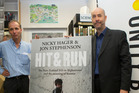 Authors Nicky Hager (left) and Jon Stephenson with their book Hit & Run. The Prime Minister said he would look at the possibly of an investigation today. Photo/Mark Mitchell