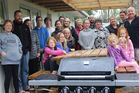 Members of the extended Chapman family with the barbecue they gave to the Dannevirke Camping Ground in the Lower Domain. Campground manager Kim Spooner is second from right.