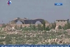 Syrian TV journalist Hosein Motada reports from the edge of Sharyat Airfield the morning after 59 US misslies struck the base