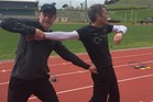 COACH: Athletics training session with Mark Harris (left) and Jimmy Hildreth. PICTURE / SPORT WHANGANUI