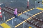 A train driver had to apply the emergency brakes on a service at Mount Eden station this morning after a woman crossed in front of the train.