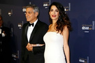 George and Amal Clooney. Photo / AP