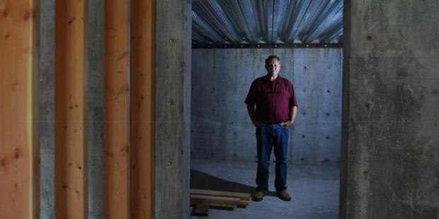 Loading Chris Walsh of Revolutionary Realty poses for a portrait in a cellar of an unfinished home for sale. Photo / Washington Post via Getty Images