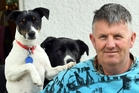 Kev Bonney, pictured with his dogs Riggs and Milo, wants the cyst near the top of his skull (bottom) removed as soon as possible. Photo / ODT