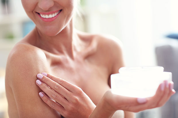 Don't forget to moisturise your neck and chest area. Photo / Getty Images