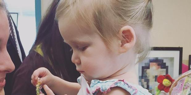 Marian McGlocklin, 19 months, has been diagnosed with 'childhood Alzheimer's' known as NPC. Photo / Facebook, Hope For Marian