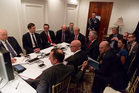 The Mar-a-Lago war room as President Trump watches US missile strikes on the Sharyat Airfield in Syria. Photo / Twitter, Sean Spicer