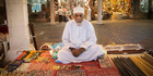 Merchant in Muscat's Souk, Muscat, Oman, Middle East. Photo / Getty Images