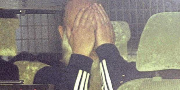 Loading Derek Percy covers his face as he is driven into the St Kilda Road police complex to give evidence about his cache of violent sex and torture fantasies. Photo / News Corp