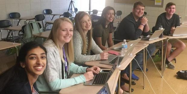Gina Mathew, Kali Poenitske, Maddie Baden, Trina Paul, Connor Balthazor and Patrick Sullivan prepare to Skype with newly hired principal Amy Robertson. Photo / Emily Smith, Pittsburg High School