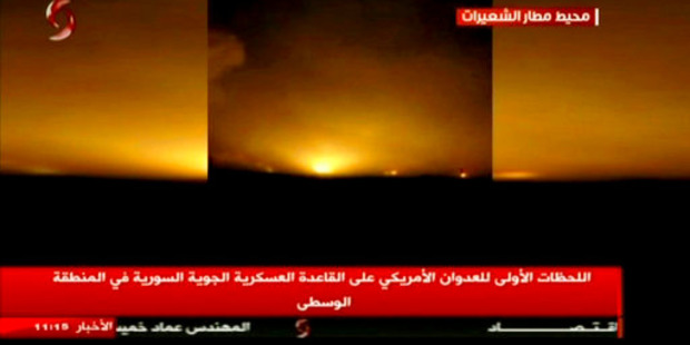 This frame grab from video provided by Ikhbaria TV, a Syrian pro-government TV channe, shows flames rising from US Tomahawk missiles. Photo / AP