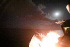 In this image provided by the US Navy, the guided-missile destroyer USS Porter launches a tomahawk land attack missile. The Russians claim four children were killed in the strike. Photo / AP