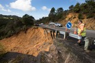 A road inspection contractor inspects for damage to State Highway 25 Whitianga, Tairua Road. Photo / Brett Phibbs