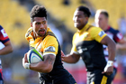 Ardie Savea of the Hurricanes runs with the ball with Julian Savea in support. Photo / Photosport