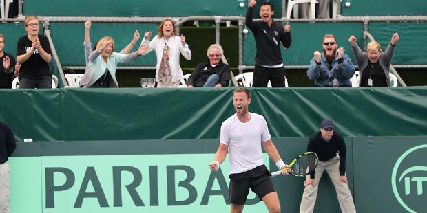 New Zealand's Michael Venus reacts as he wins the Davis Cup deciding match against Korea's Seong Chan Hong. Photo / Photosport