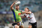 Elliot Whitehead of the Raiders looks to offload in the tackle of Kieran Foran of the Warriors. Photo / Photosport