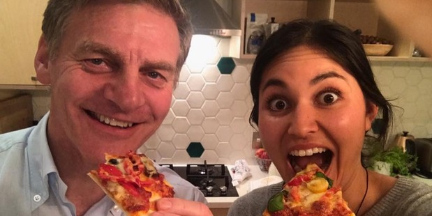 Loading Prime Minister Bill English and celebrity chef Nadia Lim enjoy a slice of spaghetti-free pizza. Photo/Facebook