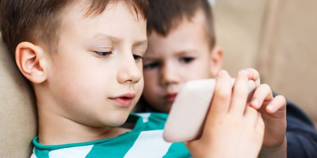 Once the kid leaves the house with the phone, all bets are off. Photo / 123RF