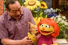 Sesame Street locals including Alan Muraoka helped to quickly introduce Julia and explain her autism. Photo / AP