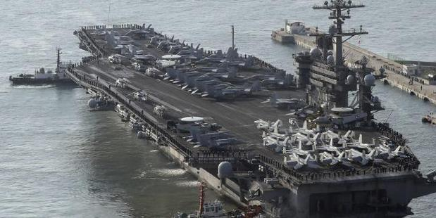 Loading US Navy aircraft carrier, the USS Carl Vinson, is moving towards the western Pacific Ocean to provide a physical presence near the Korean Peninsula. Photo/AP