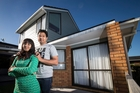 Bharat Bhushan and Lovely Garg, outside their previous rental property, cut their budget to buy a $550,000 townhouse in Glen Eden. Photo / Jason Oxenham