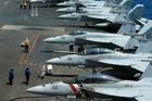 A row of F18 fighter jets on the deck of the USS Carl Vinson, which is headed to the Korean Peninsula. Photo / AP