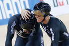 New Zealand's Eddie Dawkins, left, and Ethan Mitchell celebrate after winning the gold medal in the Men's Team Sprint. Photo / AP