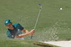 Sergio Garcia, of Spain, hits from a bunker on the second hole during the final round of the Masters. photo / AP