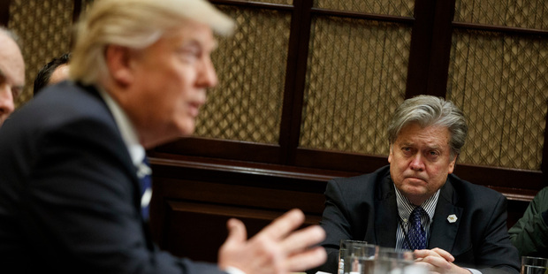 Loading White House Chief Strategist Steve Bannon listens at right as President Donald Trump speaks during a meeting on January 31. Photo / AP