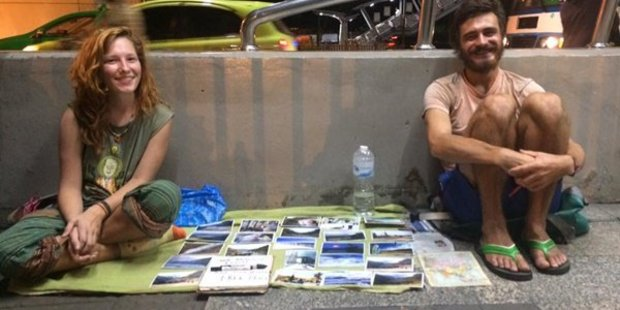 Backpackers selling postcards in Thailand. Photo / Twitter, Solo Traveller