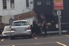 A still from a Herald video showing a man whose wheel was clamped within seconds of him leaving a Mt Eden car park.