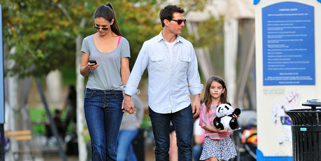 Katie Holmes, Tom Cruise and Suri Cruise visit Schenley Plaza's carousel in 2011. Photo / Getty