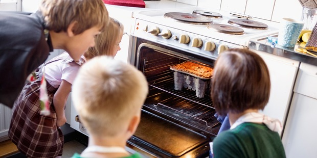 Avoid opening the oven too many times or your food could be cooked unevenly. Photo / Getty Images