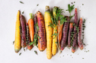 Carrots started off purple and black, food experts say, but they died out as people favoured their more cheerfully coloured counterparts. Photo / Getty Images