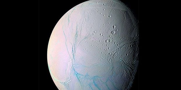 Loading Nasa's Cassini spacecraft has picked up the first evidence that chemical reactions are happening deep below the ice on Saturn's moon, Enceladus. Photo / Getty Images