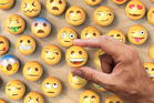 The Clover dating app looked at user behavior to see which emojis were most likely to elicit a response. Photo / Getty.