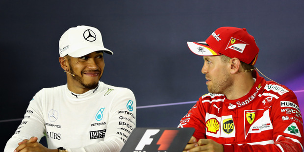 Sebastian Vettel and Lewis Hamilton talk in the post race press conference. Photo / Getty Images