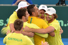 Nick Kyrgios of Australia celebrates victory with team-mates after his match against Sam Querrey of the USA during the Davis Cup World Group Quarterfinals. Photo/Getty Images