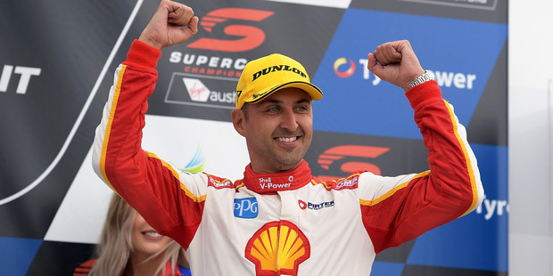 Fabian Coulthard celebrates after winning race four of the Tasmania SuperSprint. Photo/Getty Images