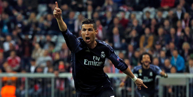 Real Madrid's Cristiano Ronaldo celebrates after scoring a goal in their win over Bayern Munich in the first leg of their Champions League quarter-final in Munich this morning (NZT). Photo / Getty.