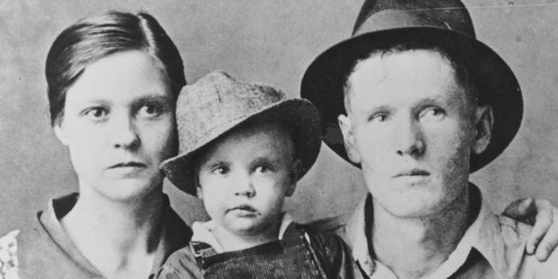 Rock and roll singer Elvis Presley poses for a family portrait with his parents Vernon Presley and Gladys Presley in 1937 in Tupelo, Mississippi. Photo / Getty