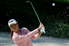 Lydia Ko hits out of the bunker. Photo / AP