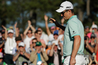 Justin Rose, of England, reacts after his birdie on the 18th hole. Photo / AP