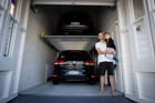 Jonathan Smith with his son Nicholas at the entrance to the family's two-car garage - with a twist. Photo/ Dean Purcell.