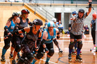 Jammer Emma Camden, aka Crush-Her, breaks through the KCDC blockers on Saturday morning.